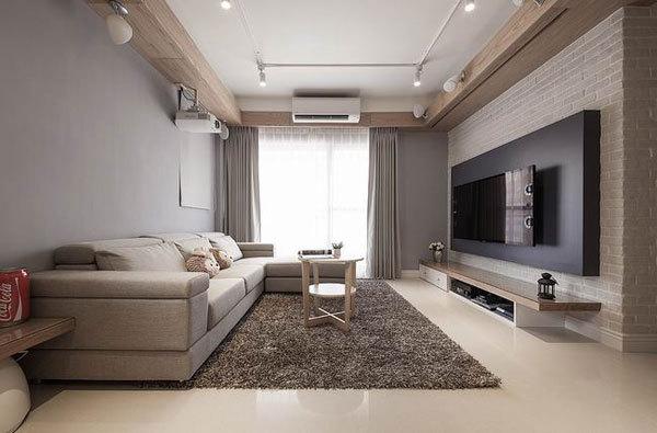 小编的话:在客厅沙发区域的地面上铺上一块灰色地毯,既耐脏又能让整间图片